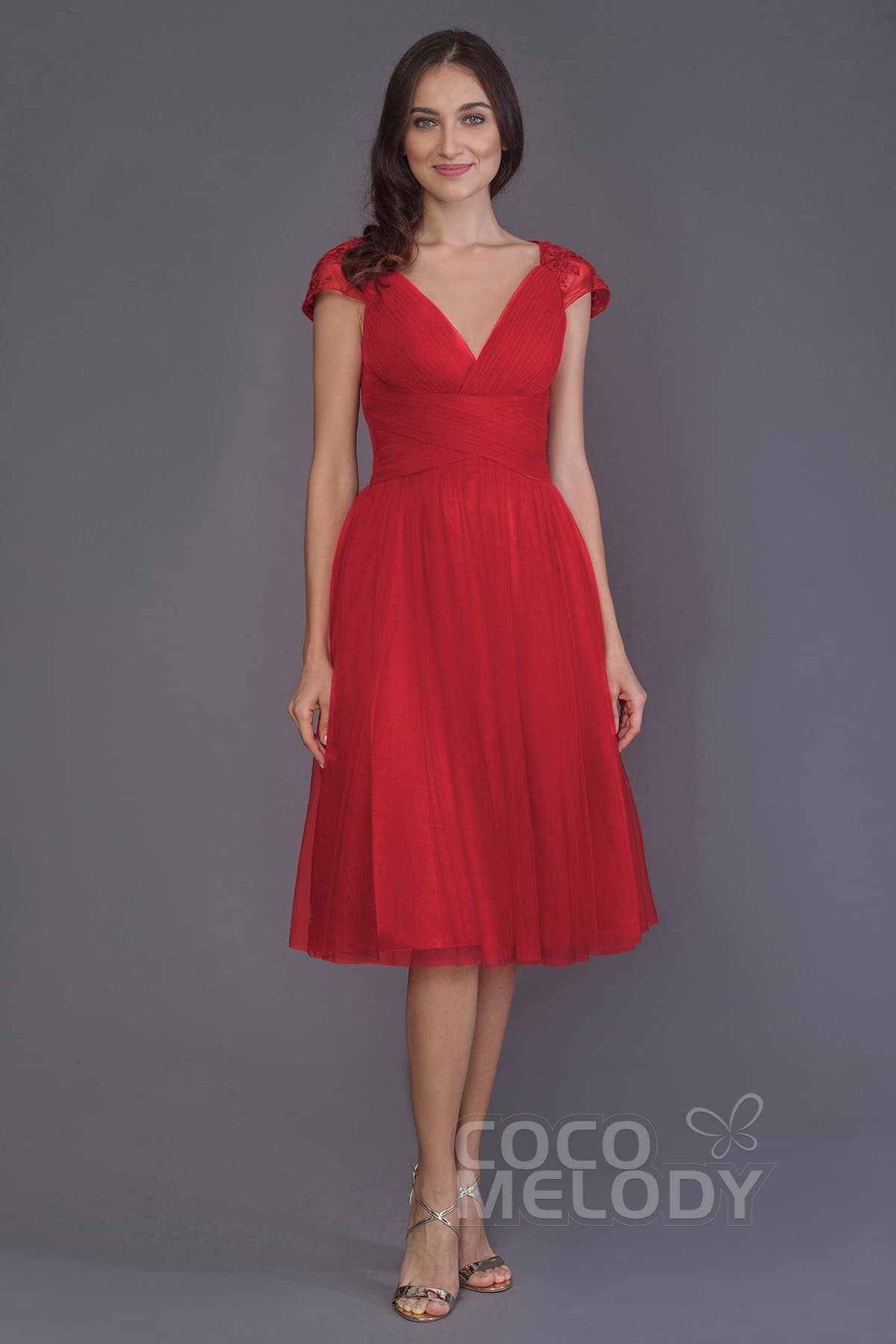 A tea-length red wedding dress
